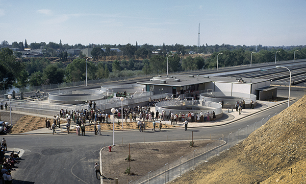 Hundreds gathered in front of the hatchery spawning building for the Dedication Ceremony for the Feather River Fish Hatchery in Oroville, California. The Salmon and Steelhead hatchery is operated by the California Department of Fish and Game and funded by the Department of Water Resources. Photo taken October 11, 1967.