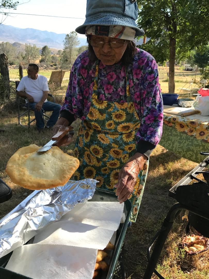 Lena Begay makes fry bread for family and guests of DWR at the Miranda allotment.