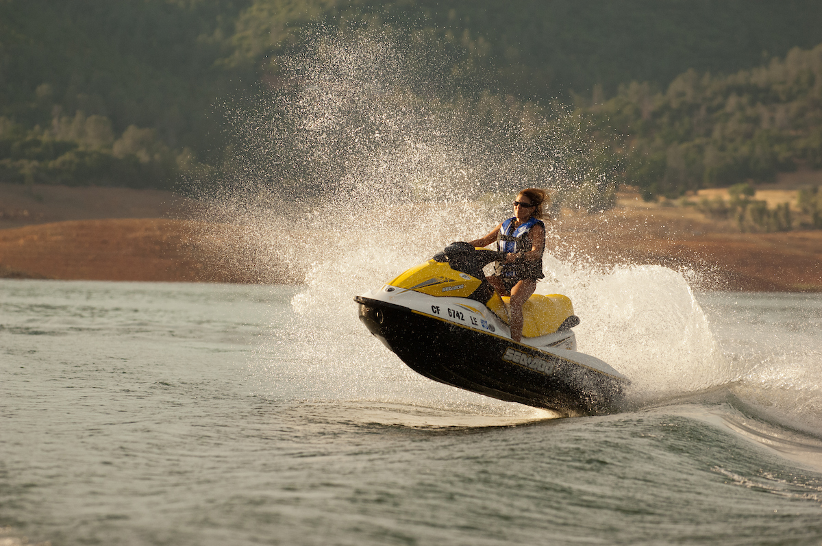 A woman enjoys jet skiing at Lake Oroville