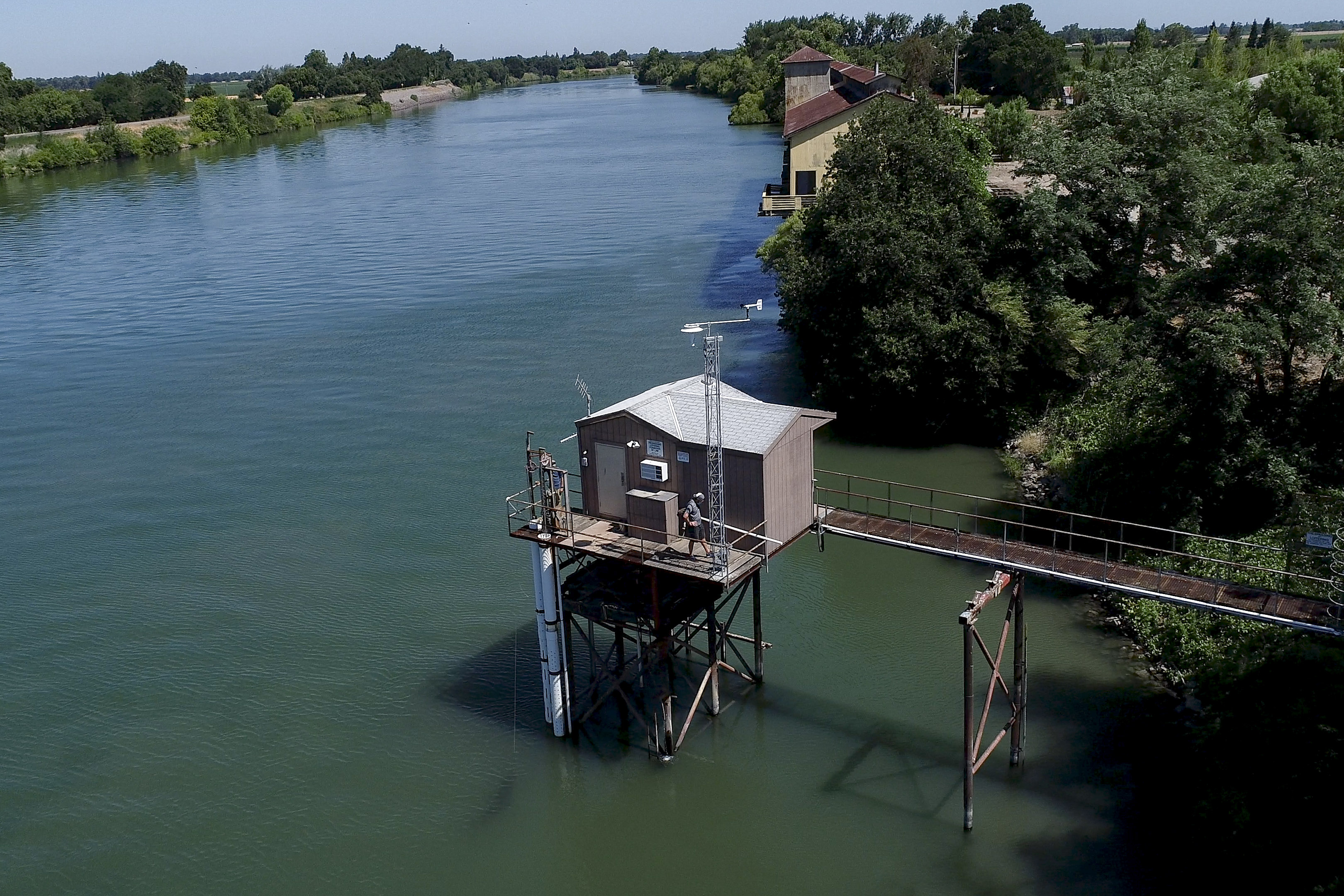 CEMP monitoring sites, resembling sheds, on the Sacramento-San Joaquin Delta house state-of-the-art water quality sampling and recording technology.