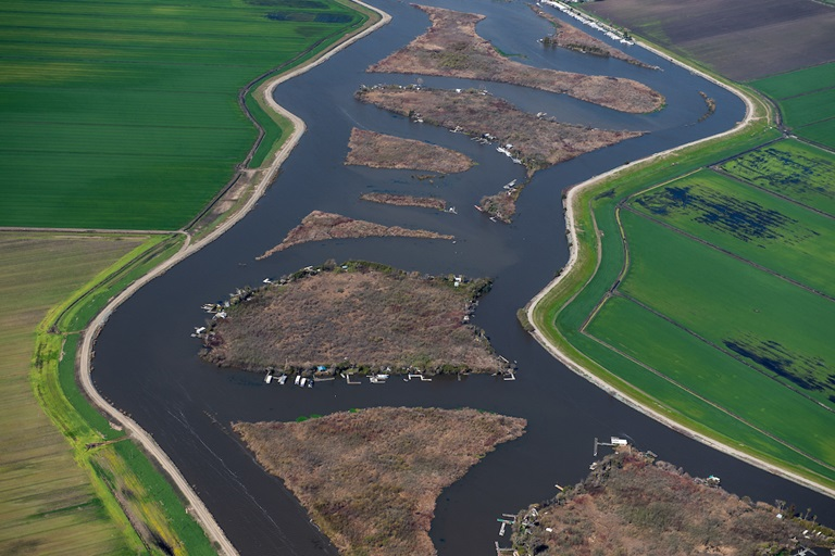 Aerial view looking east White Slough center, left is Rindge Tract and right is King Island, all part of the Sacramento-San Joaquin River Delta in San Joaquin County, California.