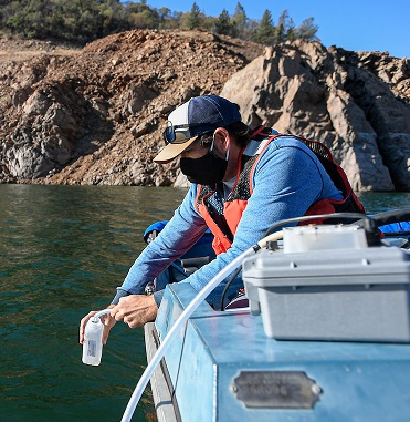 DWR water quality experts collect samples from Lake Oroville for testing.
