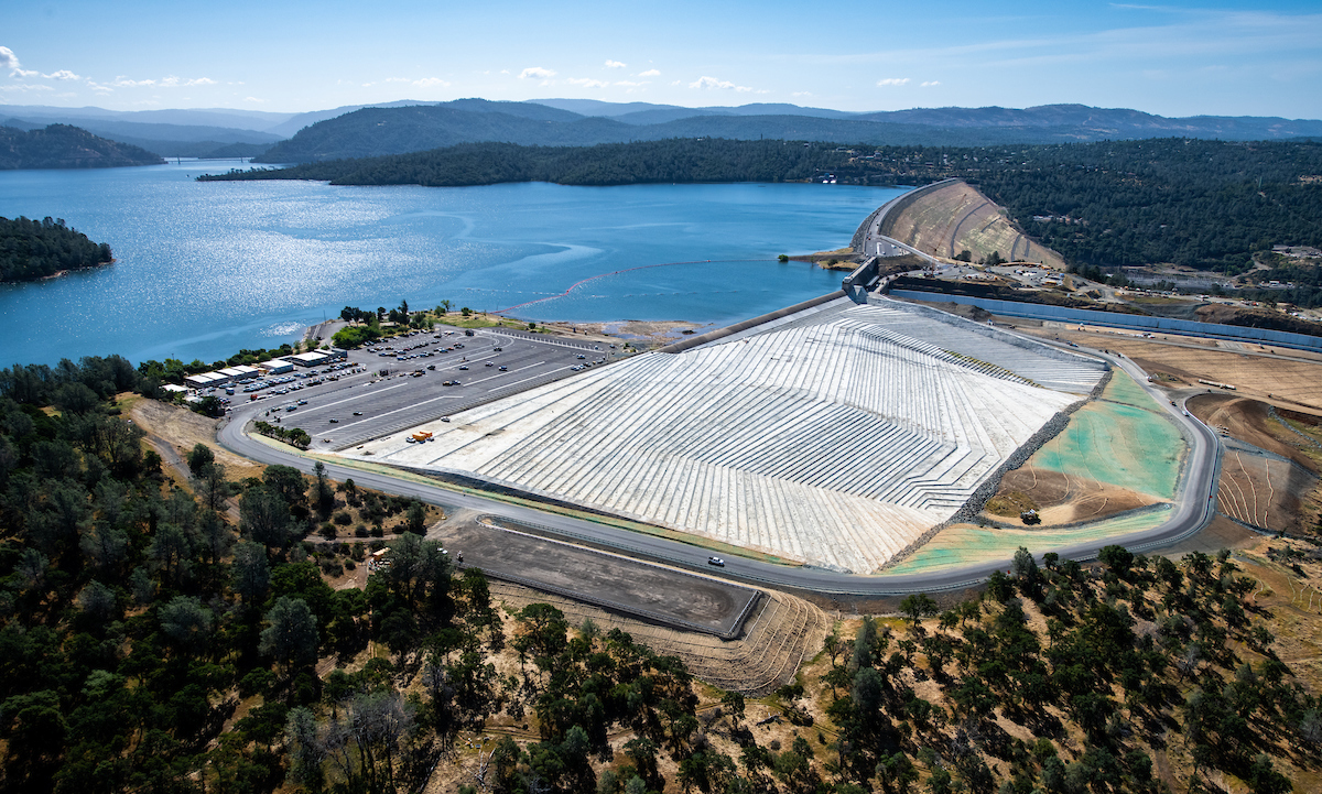 Aerial view of Lake Oroville and the reconstructed emergency spillway and spillway boat ramp access road.