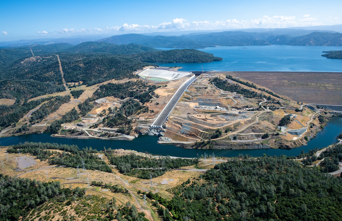 An aerial overview of Lake Oroville and the reconstructed Lake Oroville main spillway and emergency spillway at the Butte County, California site.