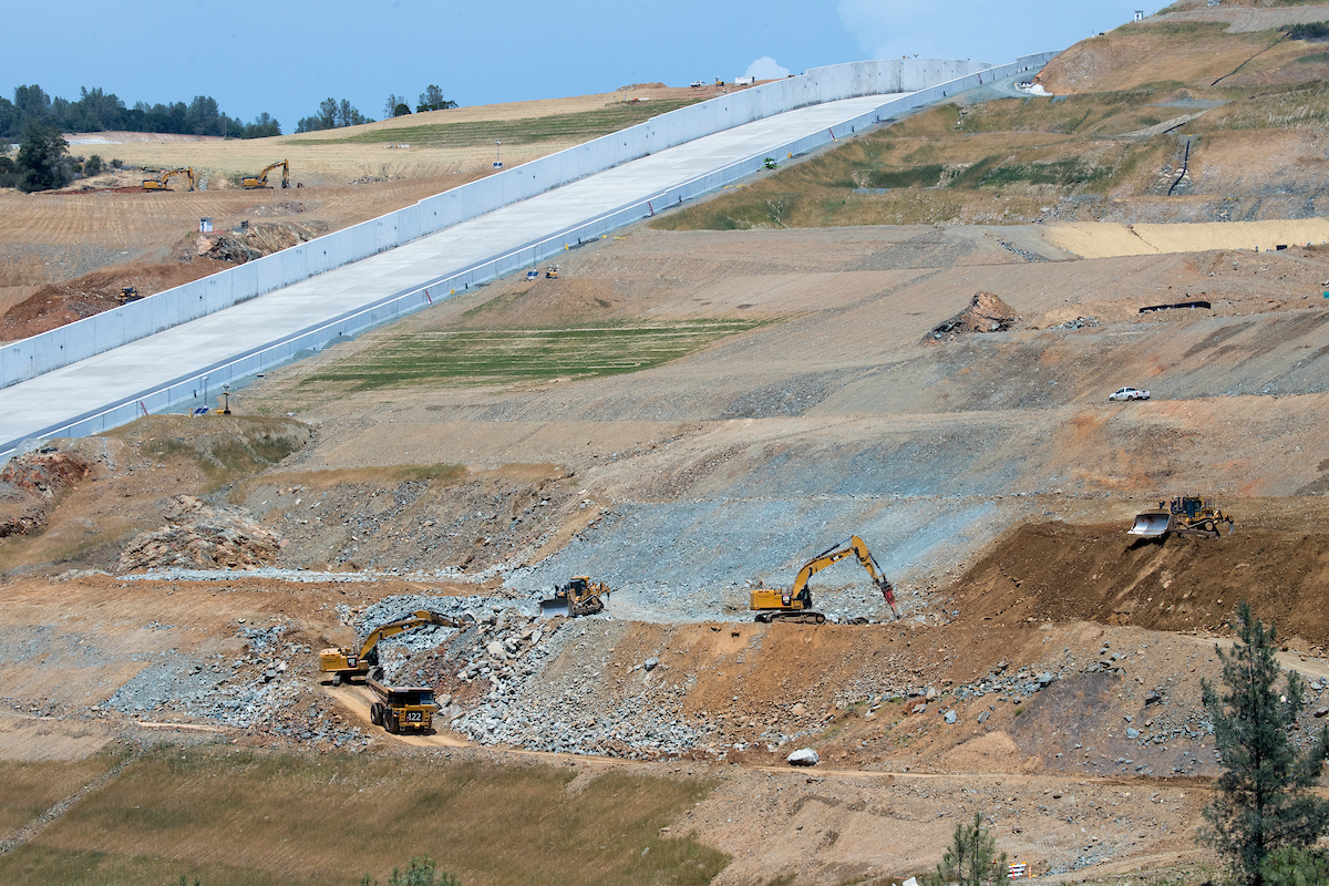 A view of the Lake Oroville main spillway as heavy equipment crews work to remove blast material from the nearby hillside at the Butte County, California site. Photo taken May 30, 2019.
