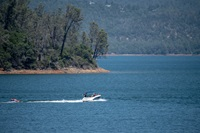 A nearly full Lake Oroville provides perfect conditions for boaters just north of the main spillway at the Butte County, California site.