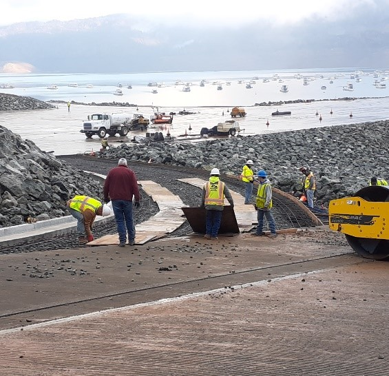 Workers prepare to pour concrete at Bidwell Canyon boat ramp Dec. 17. New paved parking lot in background.
