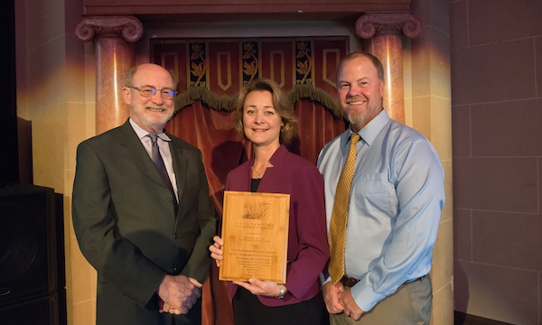 From left, John Laird, Secretary of the California Natural Resources Agency, Cindy Messer, Chief Deputy Director of the California Department of Water Resources, and Bryan Brock, DWR Sr. Engineer, stand with the Outstanding Environmental Project Award for Twitchell and Sherman Islands carbon sequestration, subsidence reversal, and wetlands, during the San Francisco Estuary Conference in Oakland, California.