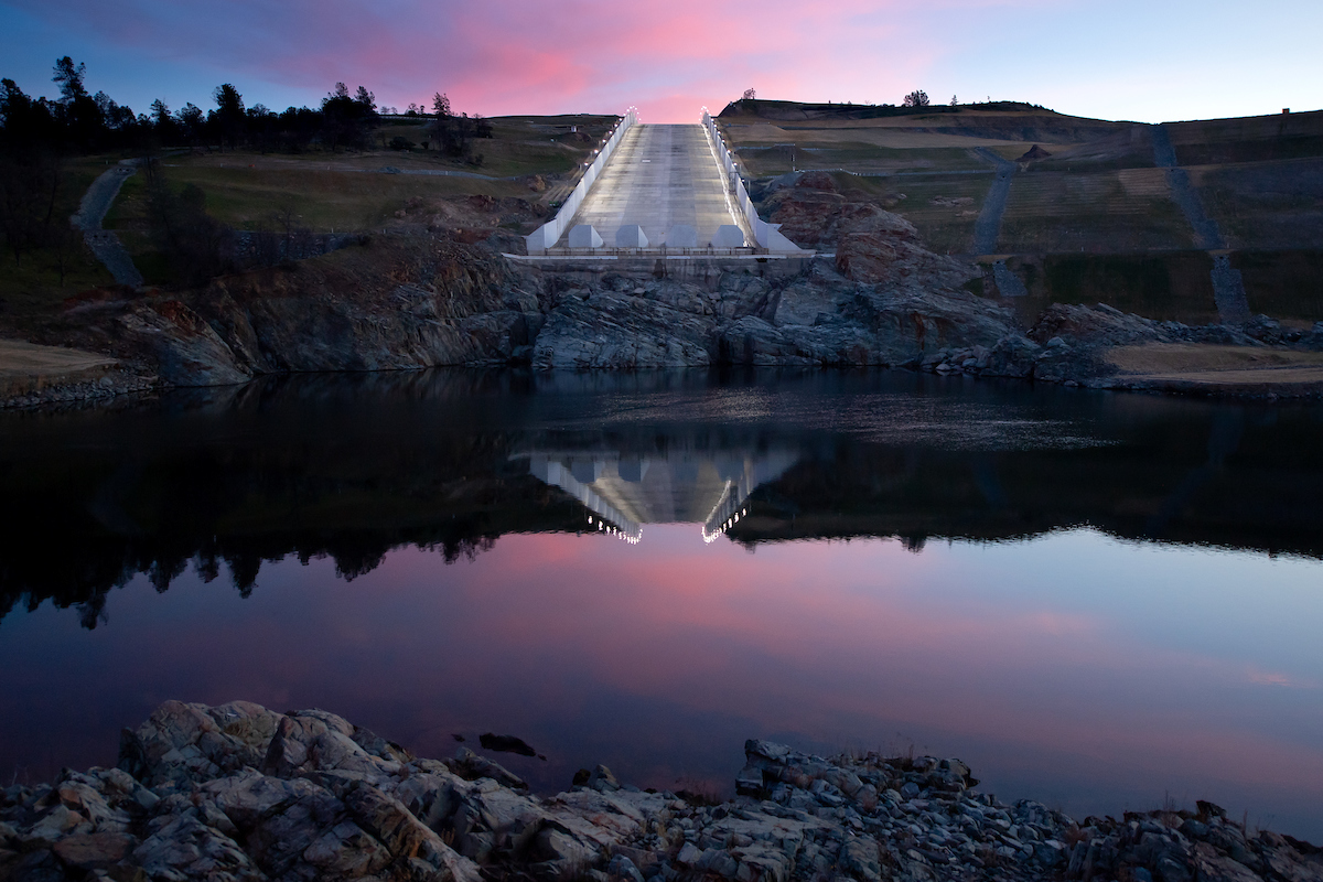 Newly installed lighting illuminates Oroville Dam's main spillway at sunrise during a continuous 24-hour period as part of activation testing.