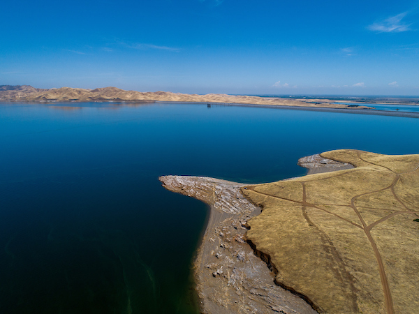 An aerial drone view of the San Luis Reservoir, located 12 miles west of the city of Los Banos near the historic Pacheco Pass, is part of the San Luis Joint-Use Complex.