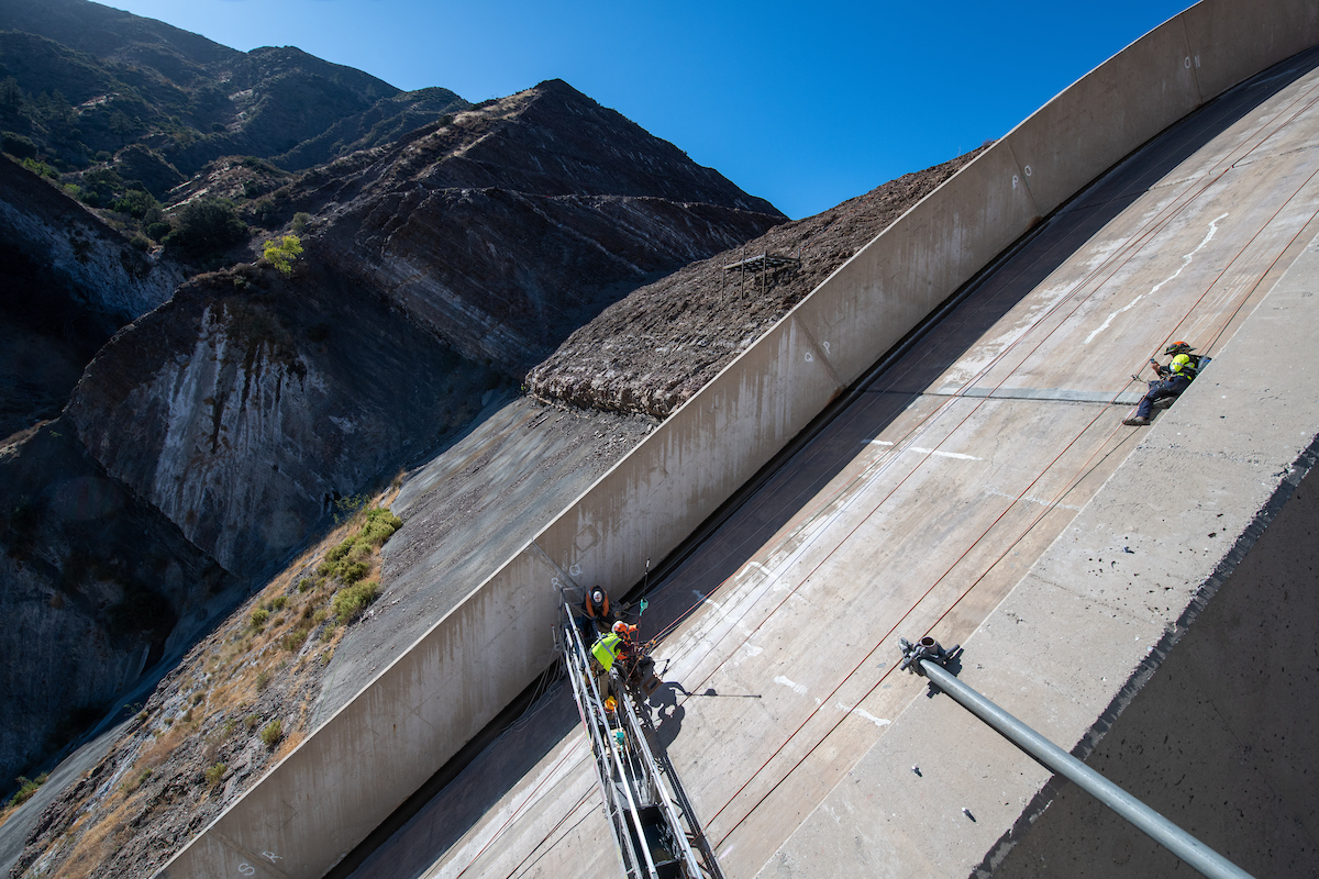Crews install piezometers on the gated spilway for the Pyramid Dam Modernization project in Los Angeles County, California.