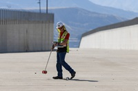 DWR engineering geologist Chris Silva marks drill hole locations for initial assessments at Castaic Dam's spillway in Los Angeles County.