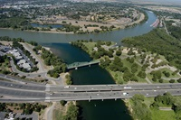 Photo of the confluence of the Sacramento River (top) and the American River (bottom), north of Sacramento, California