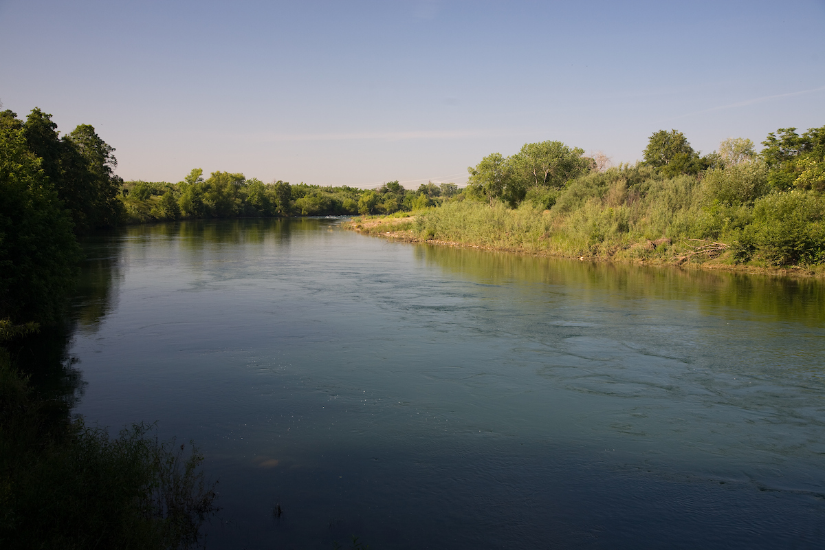The Yuba River flows east to west from the Sierra Nevada Mountains into the Sacramento Valley in Northern California.